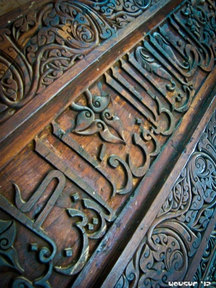 Arab scriptures carved in wood